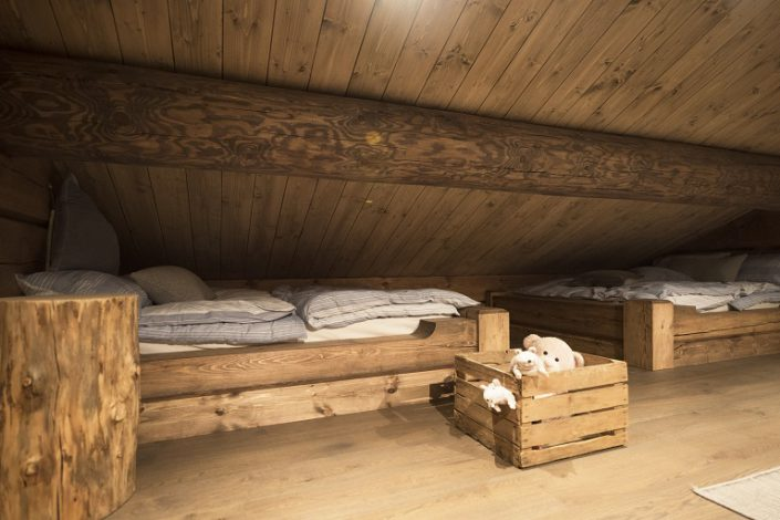 Log bed for cabin LHM1. LHM Interior
